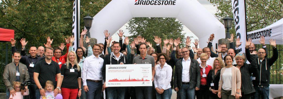 """Bridgestone Mitarbeiter in Bad Homburg laufen für die Initiative """"DU MUSST KÄMPFEN!"""""""